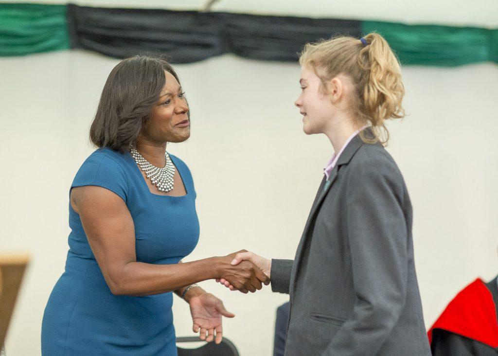 SCHS Alumna and opera sopranao Elizabeth LlewelIyn shakes hand with SCHS girl on Speech day